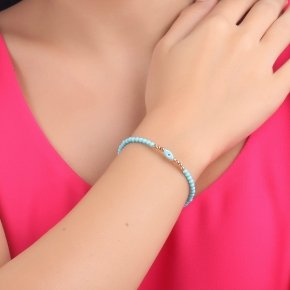 Bracelet in silver 925 pink gold plated with turquoise and an eye out of fildisi - Fildisi